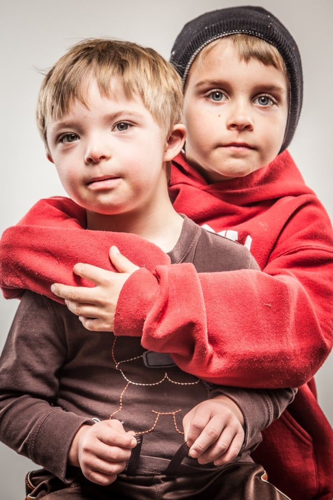Portrait of two young boys posiing and embracing